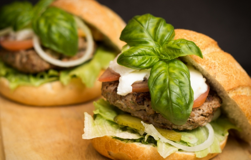 hamburgers dressed with cheese and bail