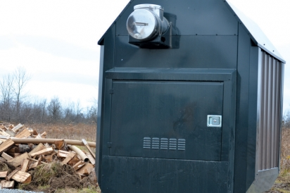 The high-efficiency wood boiler warms the radiant floor heating system in the greenhouses.