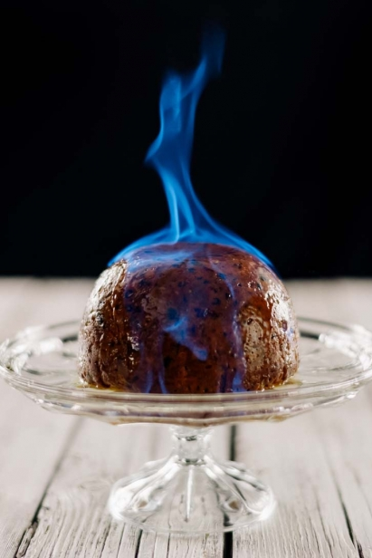 The flaming plum pudding was photographed by Ben Welland with camera and fire extinguisher in hand at Thyme & Again Creative Catering and Take Home Food Shop in Ottawa's Wellington West neighbourhood.