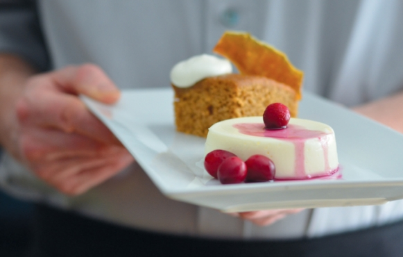 Serving sheep yogurt panna cotta with Michael's Dolce elderberry syrup and Harvey & Vern's gingerale cake.